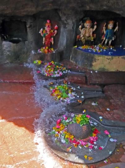 Waves splashing the Shivalings